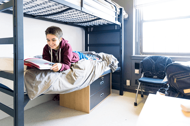 student in a dorm room